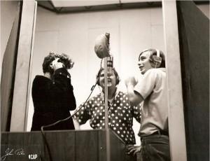 3 on mic in studio
